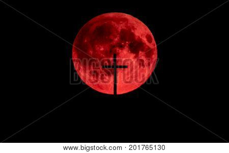 Blood moon with church cross in front