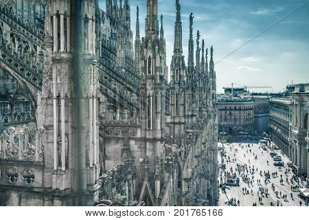 Milan Cathedral (Duomo) in Milan, Italy. Milan Duomo is the largest church in Italy and the fifth largest in the world. Piazza del Duomo in the background.