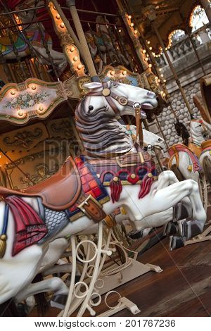 Wooden horses on a carousel at a fairground