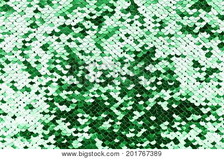 Closeup of an 80s style sequined textile. More of this motif in my port. Green sequins background or texture.