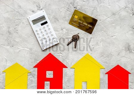 selling property online set with paper house on office desk stone background top view mockup