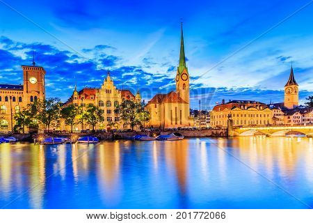 Zurich Switzerland. View of the historic city center with famous Fraumunster Church on the Limmat river.