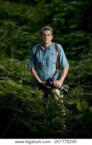 Portrait of adventure photographer in the jungle