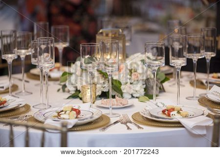 Elegant table set up for wedding reception with salads.
