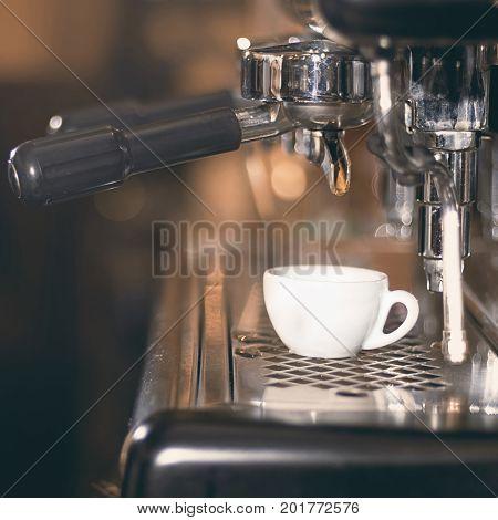 Coffee espresso. Espresso machine making coffee golden espresso flowing.