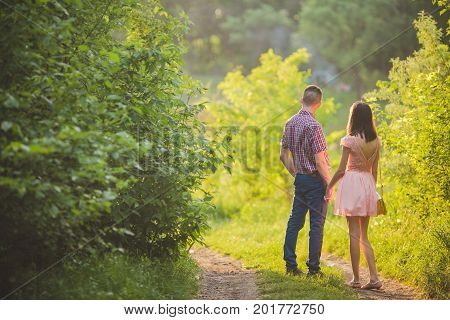 Young Couple In Love Together On Nature
