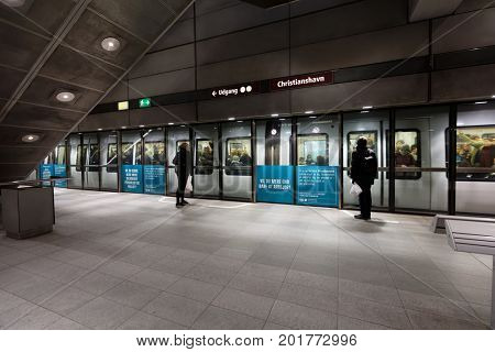 COPENHAGEN, DENMARK - NOVEMBER 5, 2016: People on the subway station Christianshavn. It is the 6th station in Denmark by passenger traffic with more than 13,000 passengers every day