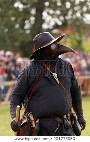ST. PETERSBURG, RUSSIA - JULY 8, 2017: Participant in the costume of plague doctor during the military history project Battle On Neva. Main event this year is the jousting tournament