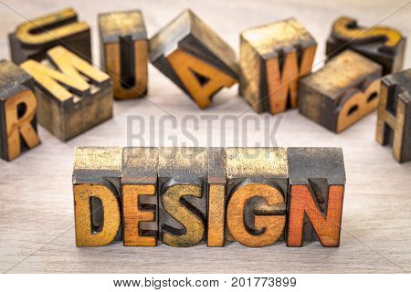 design - word abstract in  letterpress wood type printing blocks against  grained wood