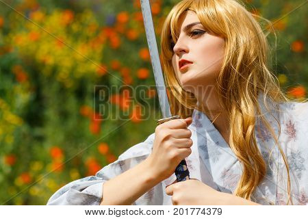 Portrait Of Samurai Girl With A Sword