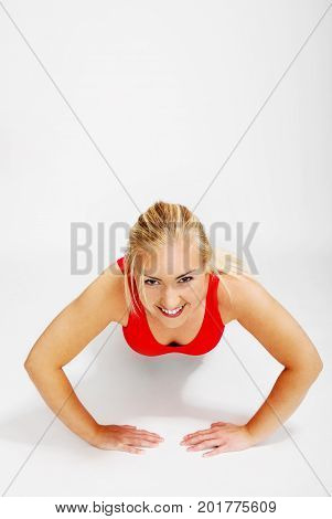 The atractive young woman is exercising pump.