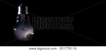 Thunder And Storm Inside Of Light Bulb On Dark Background