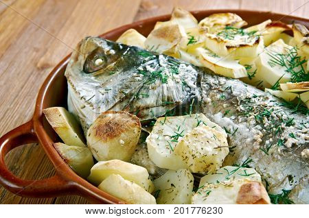 Psari sto fourno.baked fish. Cypriot cuisine close up  homemade meal