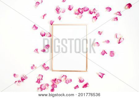 Photo frame mock up with space for text and pink rose petals on white background. Flat lay top view. Valentine's minimal background.