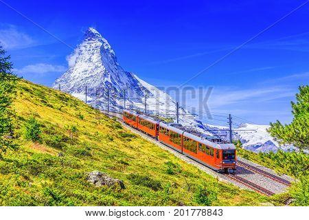 Zermatt Switzerland. Gornergrat tourist train with Matterhorn mountain in the background. Valais region.