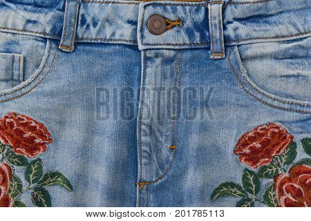 denim embroidered rose flowers jeans texture.