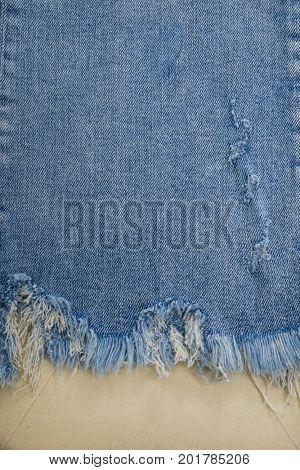 Close up blue leg jeans -khaki background