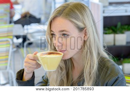 Young Blond Woman Drinking Coffee