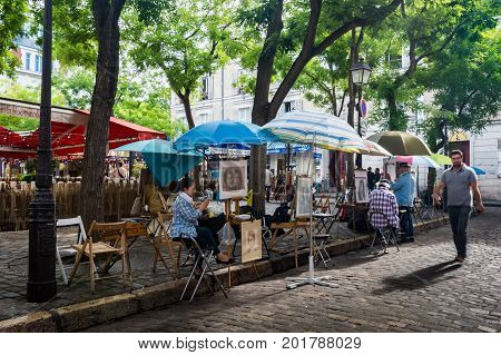 Paris France - August 14 2016: The Place du Tertre is a square in the 18th arrondissement of Paris. It is the heart of the city's elevated Montmartre quarter.