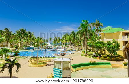 Cayo Coco island, Trip Cayo Coco, Cuba, July 11, 2017, gorgeous, amazing inviting view of hotel grounds, tropical garden and various swimming pools with people relaxing and enjoying their time