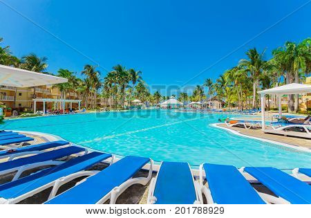 Cayo Coco island, Trip Cayo Coco, Cuba, July 11, 2017, view of hotel grounds, tropical garden and various swimming pools with people relaxing and swimming in background