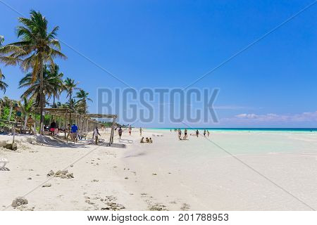 Cayo Coco island, Trip Cayo Coco, Cuba, July 11, 2017, great amazing inviting view of Cuban tropical beach and ocean with people relaxing, swimming in background