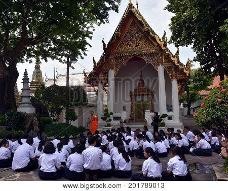 Bangkok Thailand - Aug 4 2017. Students of the Watprachetuphon School listening the buddhist monk teacher in Wat Pho temple complex.