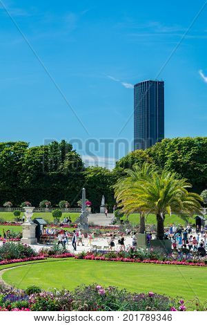 Paris France - August 14 2016: The Luxembourg garden covers 23 hectares and is known for the Luxembourg palace. We can see the Montparnasse Tower.