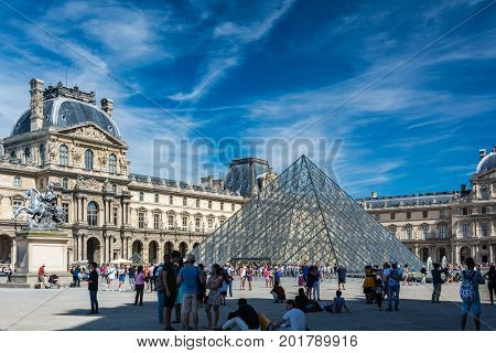 Paris France - August 13 2016: The Louvre Museum is the world's largest museum and a historic monument in Paris. A central landmark of the city it is located on the Right Bank of the Seine in the city's 1st arrondissement