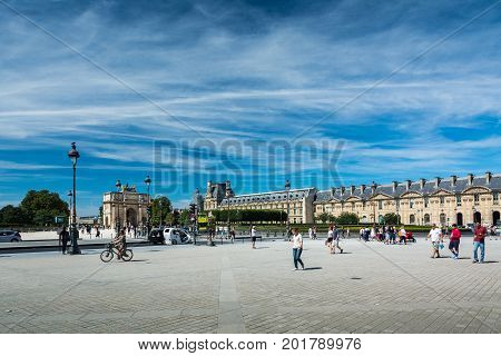 Paris France - August 14 2016: The Place du Carrousel is a public square in the 1st arrondissement of Paris sitting directly between the Louvre museum and the Tuileries Garden.