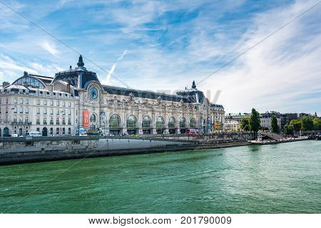 Paris France - August 14 2016: Orsay Museum seen from the right bank of the Seine river. Notice that the museum building was originally a railway station.