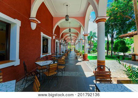 Cayo Coco island, Cuba, Colonial hotel, July 16, 2017, gorgeous amazing view of Colonial hotel grounds, beautiful inviting retro stylish outdoor cafe,building on blue sky background