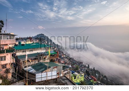 View at Darjeeling from high vantage point at foggy day, India.