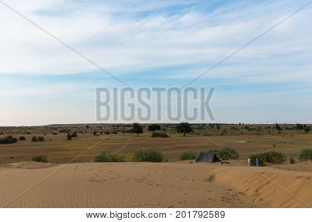 JAISALMER RAJASTHAN INDIA - MARCH 07 2016: Horizontal picture of native indian men camping in Thar Desert located close to Jaisalmer the Golden City in India.