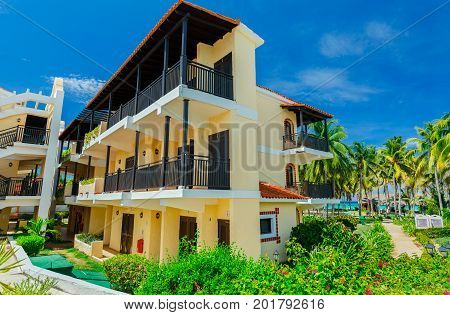 Cayo Coco island, Cuba, Colonial resort, July 16, 2017, beautiful amazing view of resort grounds with retro stylish architecture, buildings in tropical garden near the beach on blue sky background