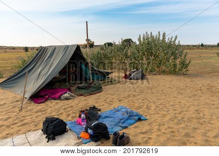 JAISALMER RAJASTHAN INDIA - MARCH 07 2016: Horizontal picture of camping tent in the sands of Thar Desert located close to Jaisalmer the Golden City in India.