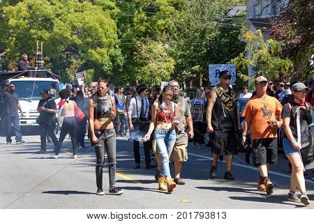 Berkeley CA - August 27 2017: Unidentified participants at the NO TO MARXISM IN AMERICA rally in Martin Luther King Jr. Civic Center Park more counter-protesters than protesters.