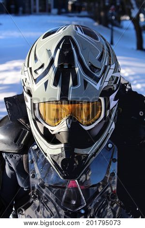 Close-up of a child wearing ATV helmet and chest protection