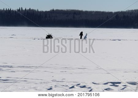Checking Out A Lonely Snowman In The Middle Of A Frozen Lake
