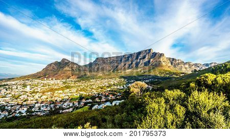 Sun setting over Cape Town, Table Mountain, Devils Peak, Lions Head and the Twelve Apostles. Viewed from the road to Signal Hill at Cape Town, South Africa