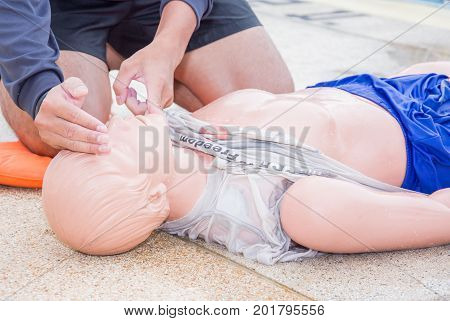 man open air way model dummy during training cpr drowning course