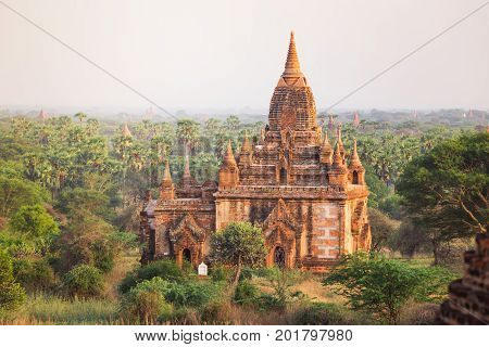 Sunrise with old temple and green lanscape Bagan Myanmar