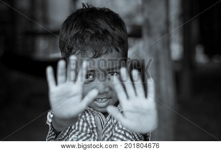 SIEM REAP CAMBODIA - MAY 2 : Closeup face of Unidentified boy of Cambodian in not permit action at kabal spean on May 2 2015 in Siem Reap Cambodia
