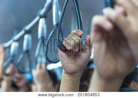 Hand handle loop in the sky train