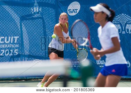 BANGKOK MAY 27 : Alina Zolotareva of Australia and Chompoothip Jandakate of thailand action in Chang ITF Pro Circuit 4 International Tennis 2015 at Rama Gardens Hotel on May 27 2015 in Bangkok Thailand.