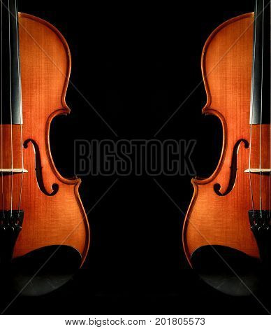 Closeup Violin orchestra musical instruments on black background