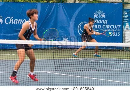 BANGKOK MAY 27 : Kamonwan Buayam of Thailand and Dabin Kim of Koria action in Chang ITF Pro Circuit 4 International Tennis 2015 at Rama Gardens Hotel on May 27 2015 in Bangkok Thailand.