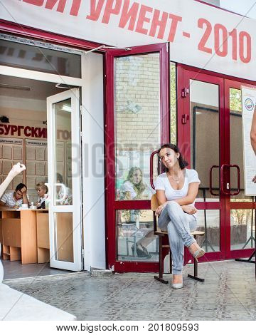 Orenburg, Russia, July 15, 2010. A Cute Girl Sits In A Reverie On A Bench At The Entrance To The Ins