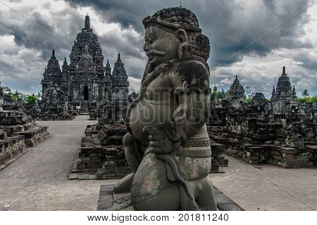 A statue of Dvarapala (guardian) at the entrance to the Candi Sewu complex