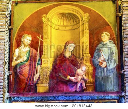 ROME, ITALY - January 19, 2017 Madonna of Clemency 15th Century Painting Pantheon Rome Italy Rebuilt by Hadrian in the Second Century Became oldest church in 609 AD Mary Baby Jesus Between John the Baptist and St Francis